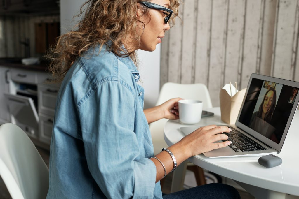 Woman in Blue Denim Jacket working from home